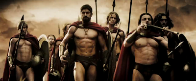 Gerard Butler and other actors stand in formation scantily clad as Spartans in the film 300